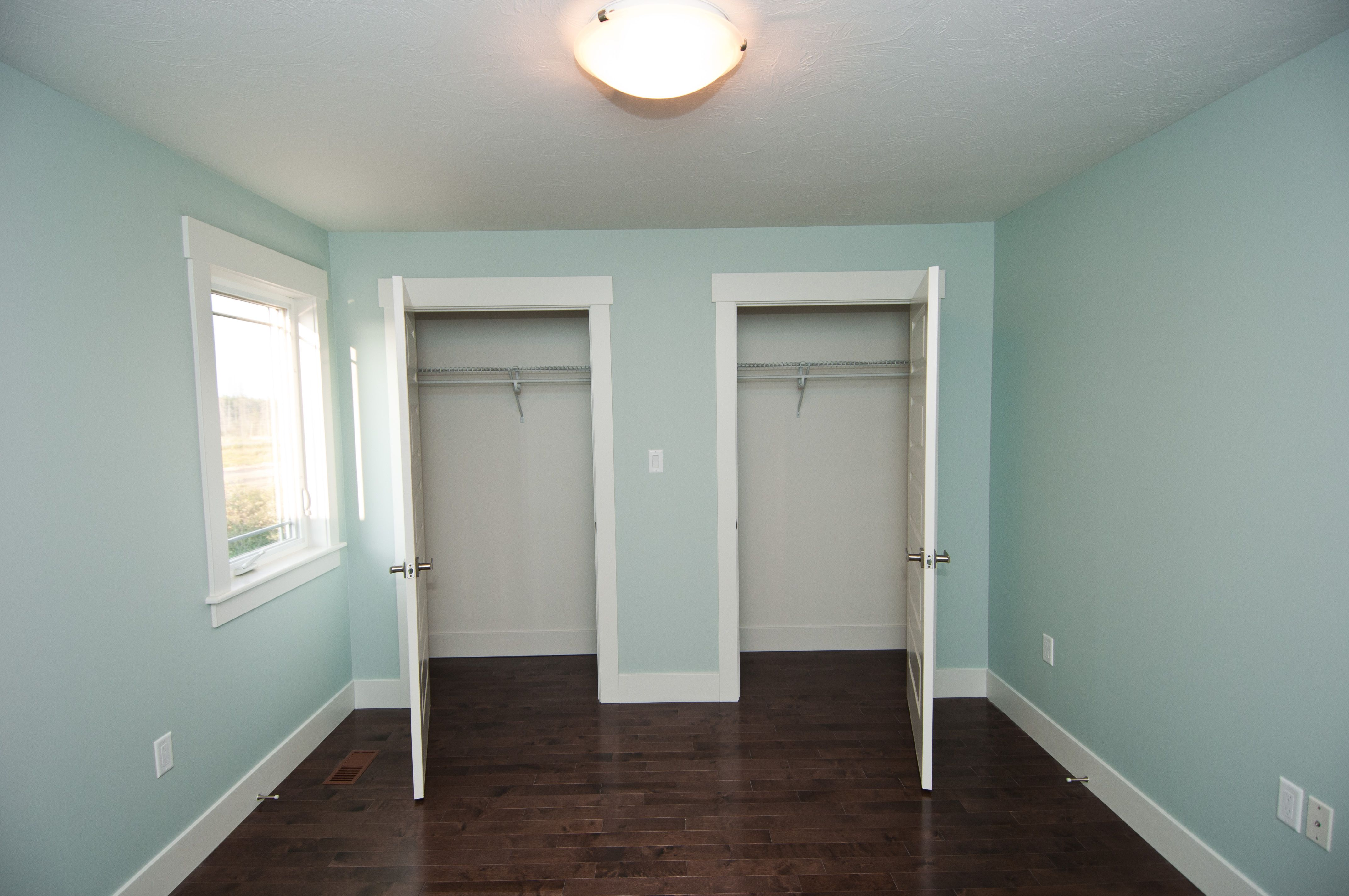 Light Turquoise Walls And Dark Brown Flooring Wow Custom Home Craft Room