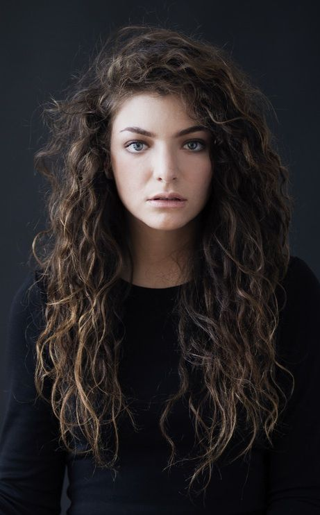 Naturally curly hair. Mine is very similar to this. Never need to straighten it or really do anything to it at all.