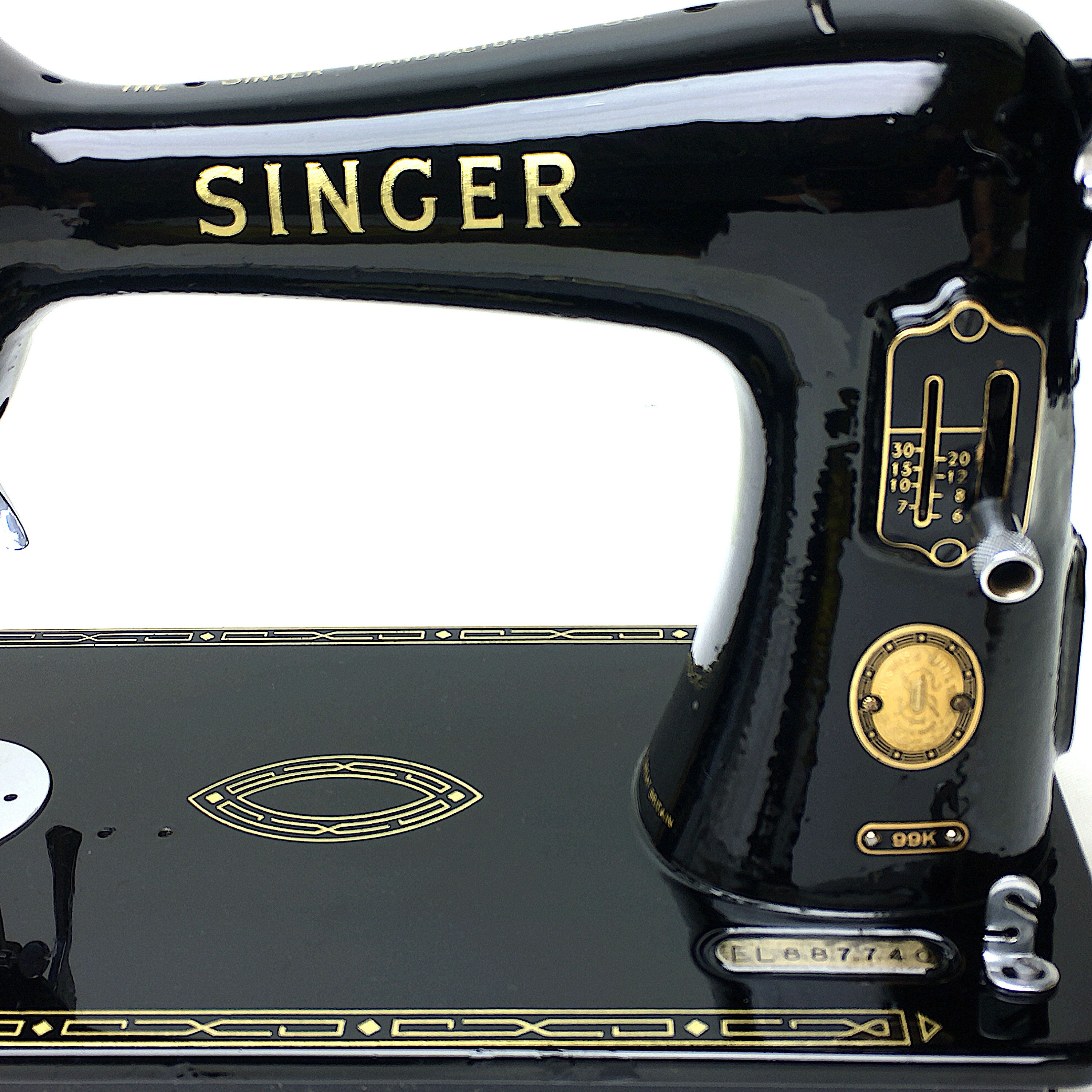 On right of image Bobbin Winder Rubber for the Singer 99k Sewing Machine
