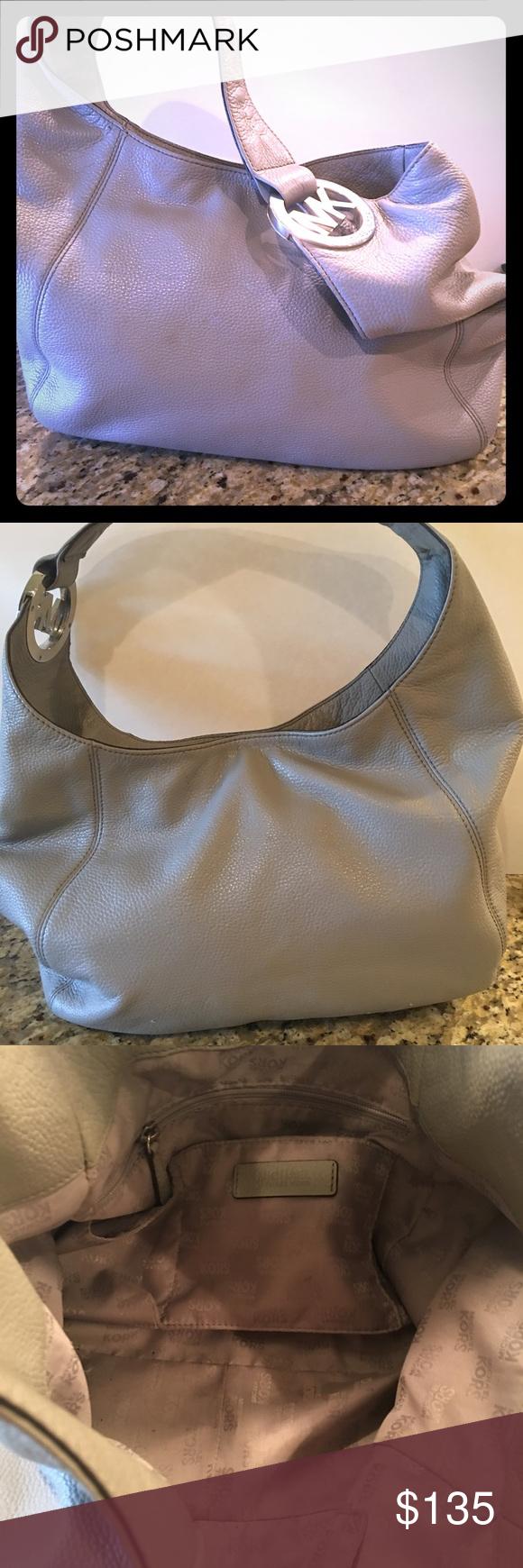 Michael Kors Hobo Handbag Beautiful gray Kors Hobo handbag! Color is versatile to carry year round! No visible flaws and has been treated with MK leather treatment. Michael Kors Bags Hobos