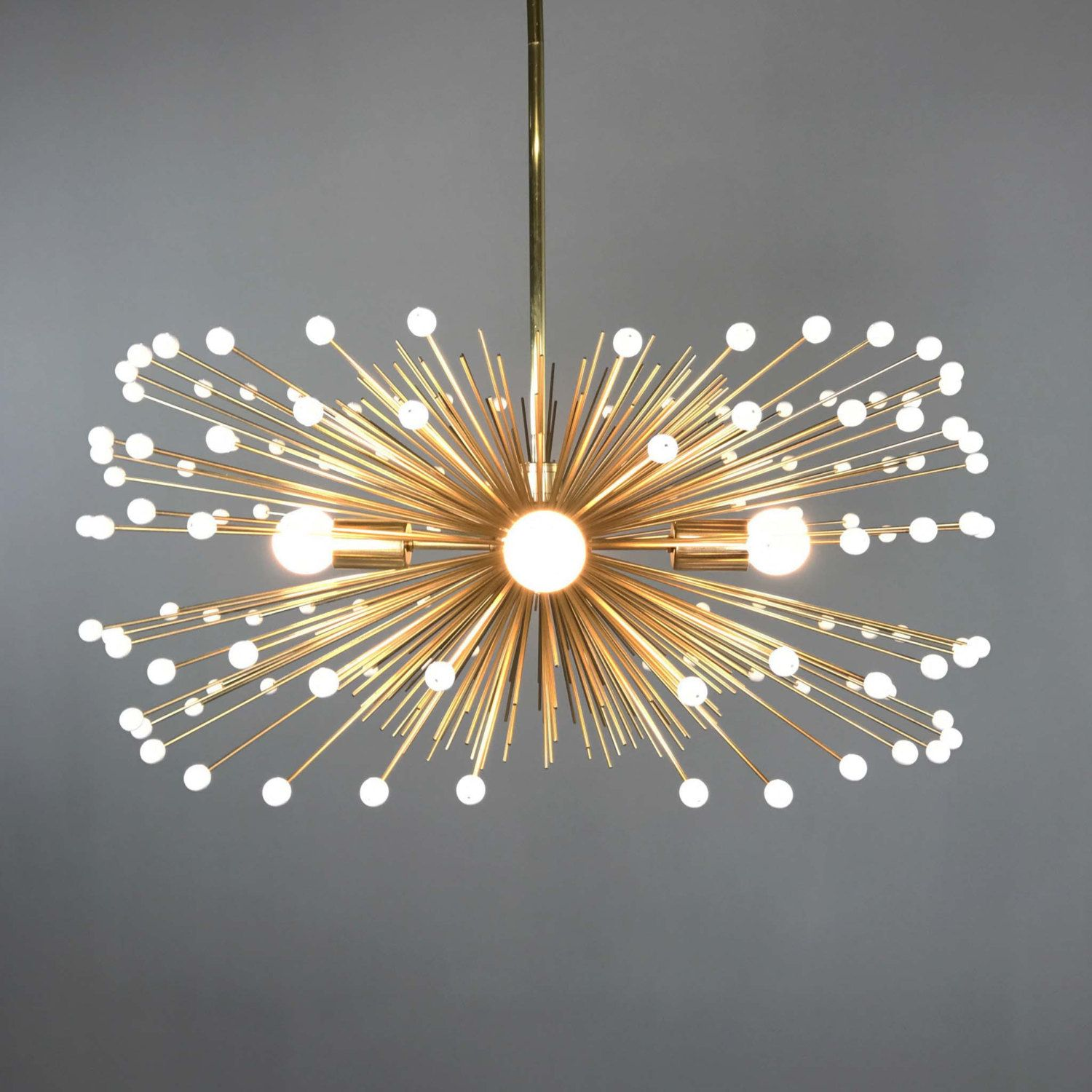 Adorned with white acrylic beads the gold urchin chandelier is a
