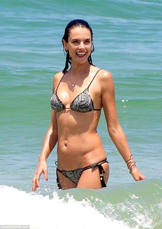 7692f7c97b Bikini babe  Alessandra Ambrosio flaunted her fantastic figure in a  patterned bikini as she hit the beach in Rio de Janeiro