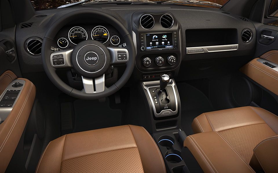 Jeep Compass Limited Offers A Modern Three Spoke Leather Wrapped Steering Wheel That Features Satin Silver Painted Spokes Speed Contr