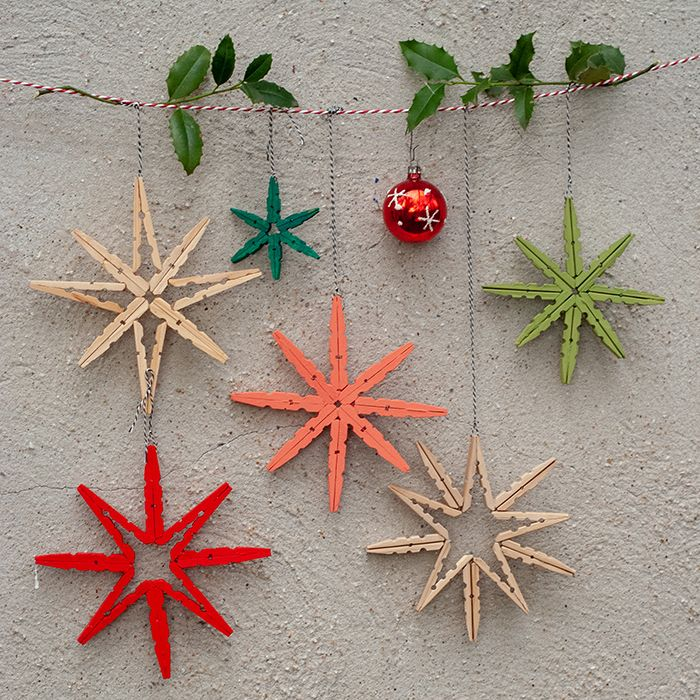 Kunterbunte DIY Deko-Sterne aus Holzwäscheklammern