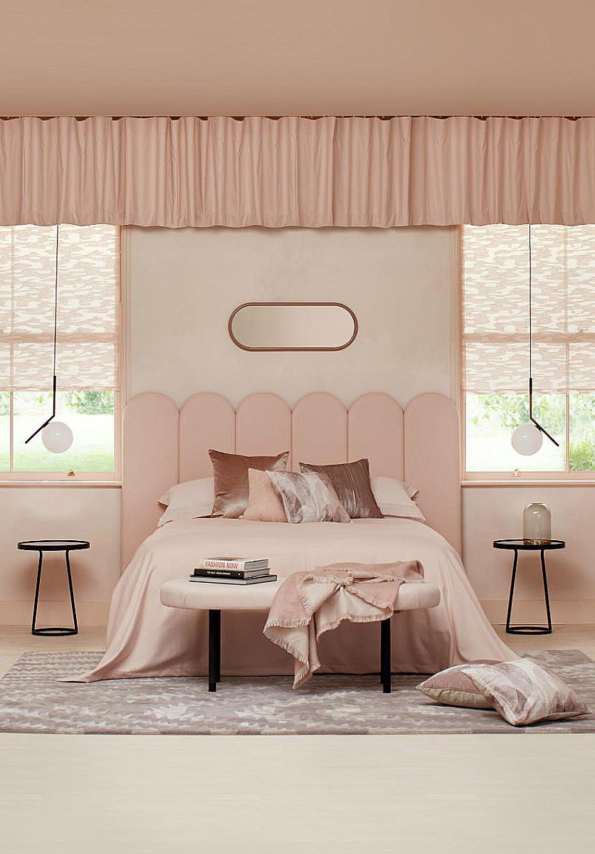 Decked out in powder pink, this sumptuous 1920s-style bedroom is elegant and eye-catching with an arched headboard, Art Deco orb lighting and a striking pelmet. Click for more pink decorating ideas #homedecor Image: Hillarys