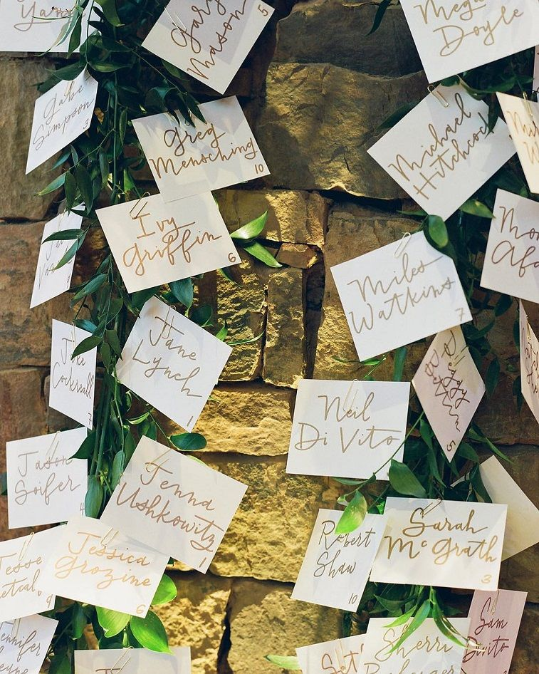 Escort cards on greenery