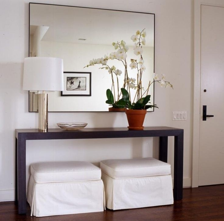 Beautiful Elegant Foyer Slipcovered White Ottomans And Modern Wood Console Table With  Chrome Lamp And Large Wall Mirror! White Paint Wall Color In Entry Foyer ...