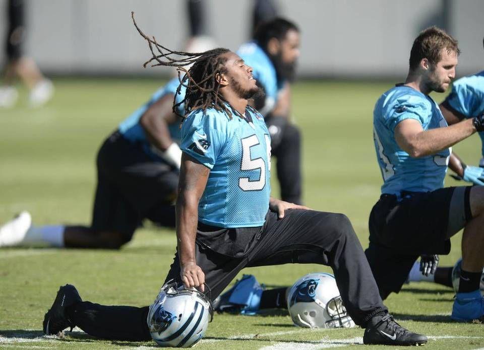 Carolina Panthers' Shaq Thompson (54) flips his dreads