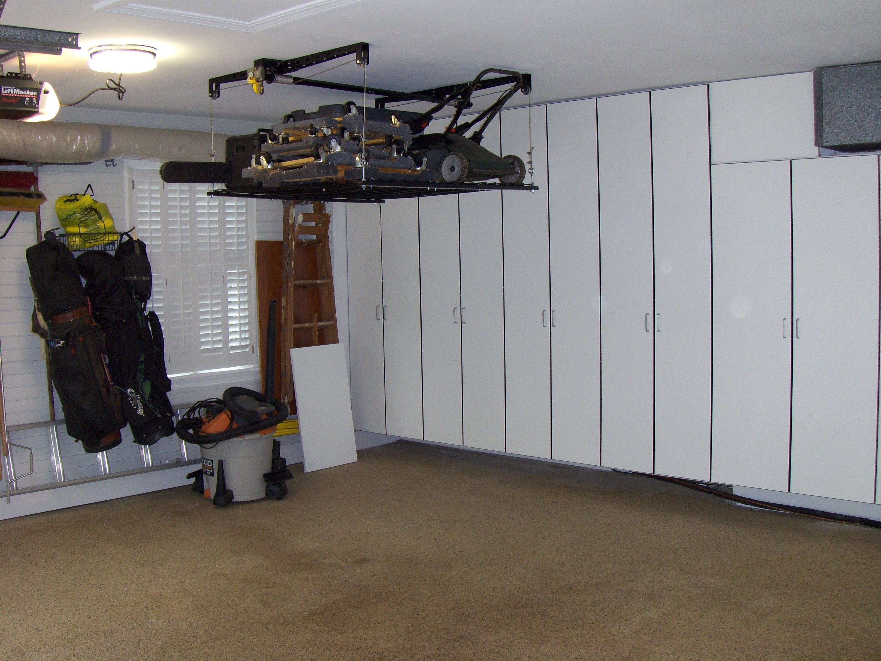 Lift For The Lawnmower And Stuff Garage Hanging Storage Garage