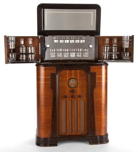 walnut veneered art deco american radiobar cocktail cabinet with glass bar ware c irca
