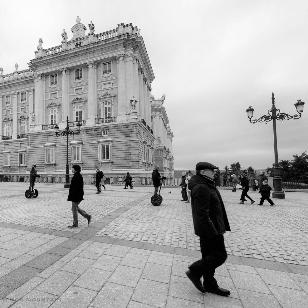 Madrid, Spain - Tourists ride by on Segway transporters outside the Royal Palace in Madrid.   #streetfinder #streetmagazine #moodygrams#shotzdelight #1stinstinct #agameoftones#igersone#bwmasters #bwstyleoftheday #jaw_dropping_shotz #photographyislife #worldshotz #main_vision #traveldreamy #worldcaptures #artofvisuals #instatravel #vacation #photostory #documentaryphoto #bnw_madrid #blackandwhiteisworththefight #bw_photooftheday#bw_crew #bnw_demand #monochromatic #tourismmadrid #spain🇪🇸