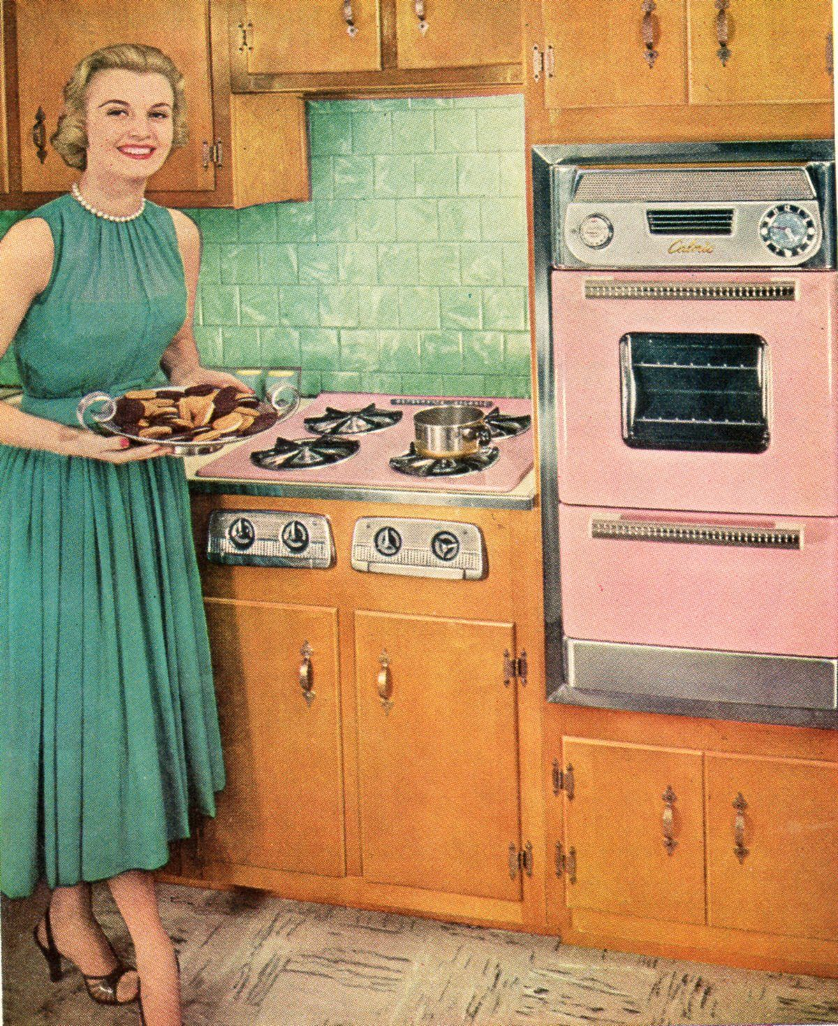 Vintage  Kitchen. Pink appliances. This would be me if I was a housewife in this time