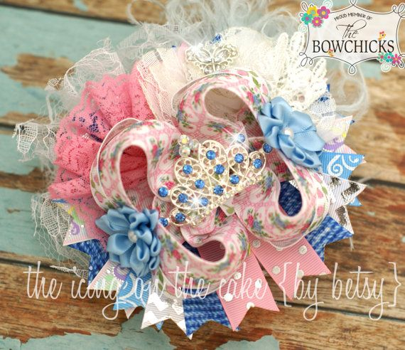 If you are looking for a bow to wear to the movie release for Cinderella you should see Betsy's Shabby Chic Princess Inspired  Boutique Bow  by icingbybetsy