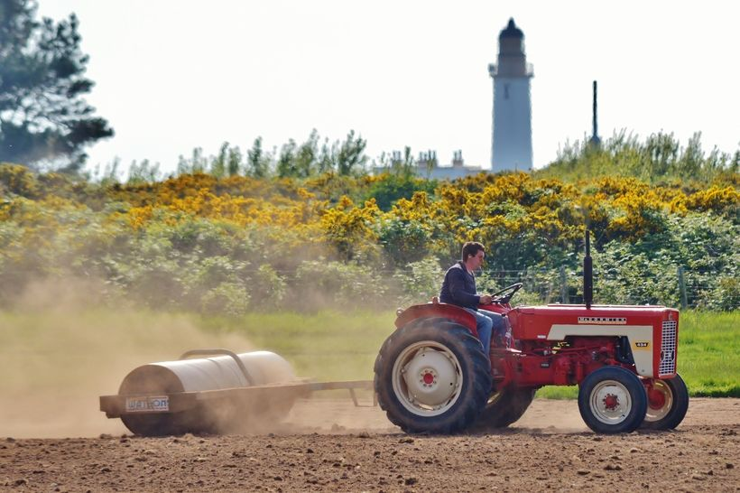 James Truesdale on his McCormick International 434 rolling new grass seed, with Turnberry Lighthouse in the background. Took with my Nikon D3200 with 55-300 lens.