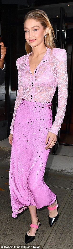 Gigi Hadid flashes her bra in semi-sheer lacy pink blouse in NYC ...