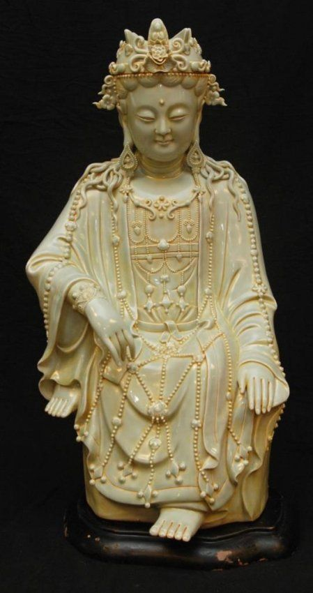 Antique And Rare Chinese Light Green Glaze Large Porcelain Sculpture  Depicting A Seated Guan Yin.