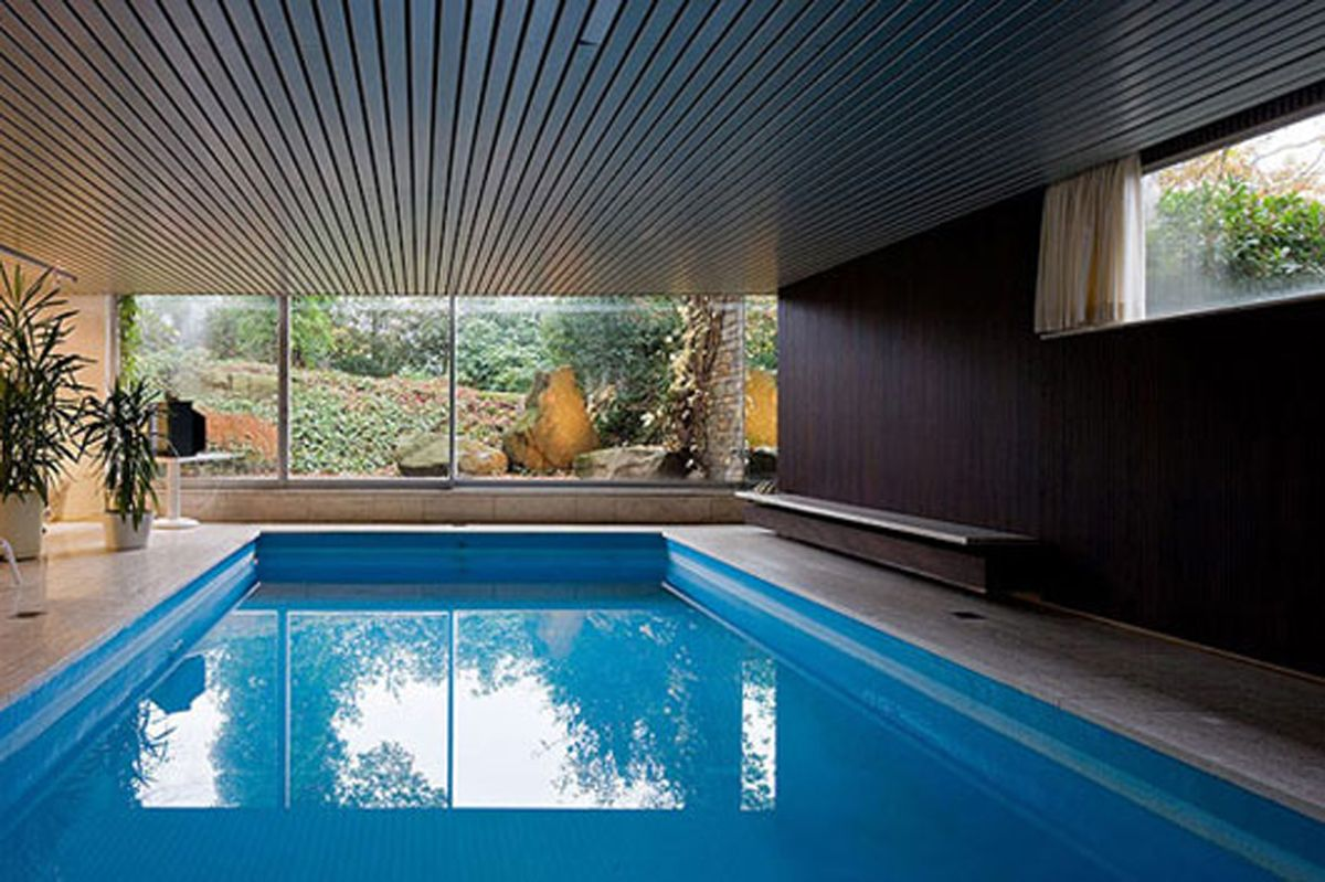 Awesome indoor swimming pool design fascinating innovative for Indoor swimming pool ideas