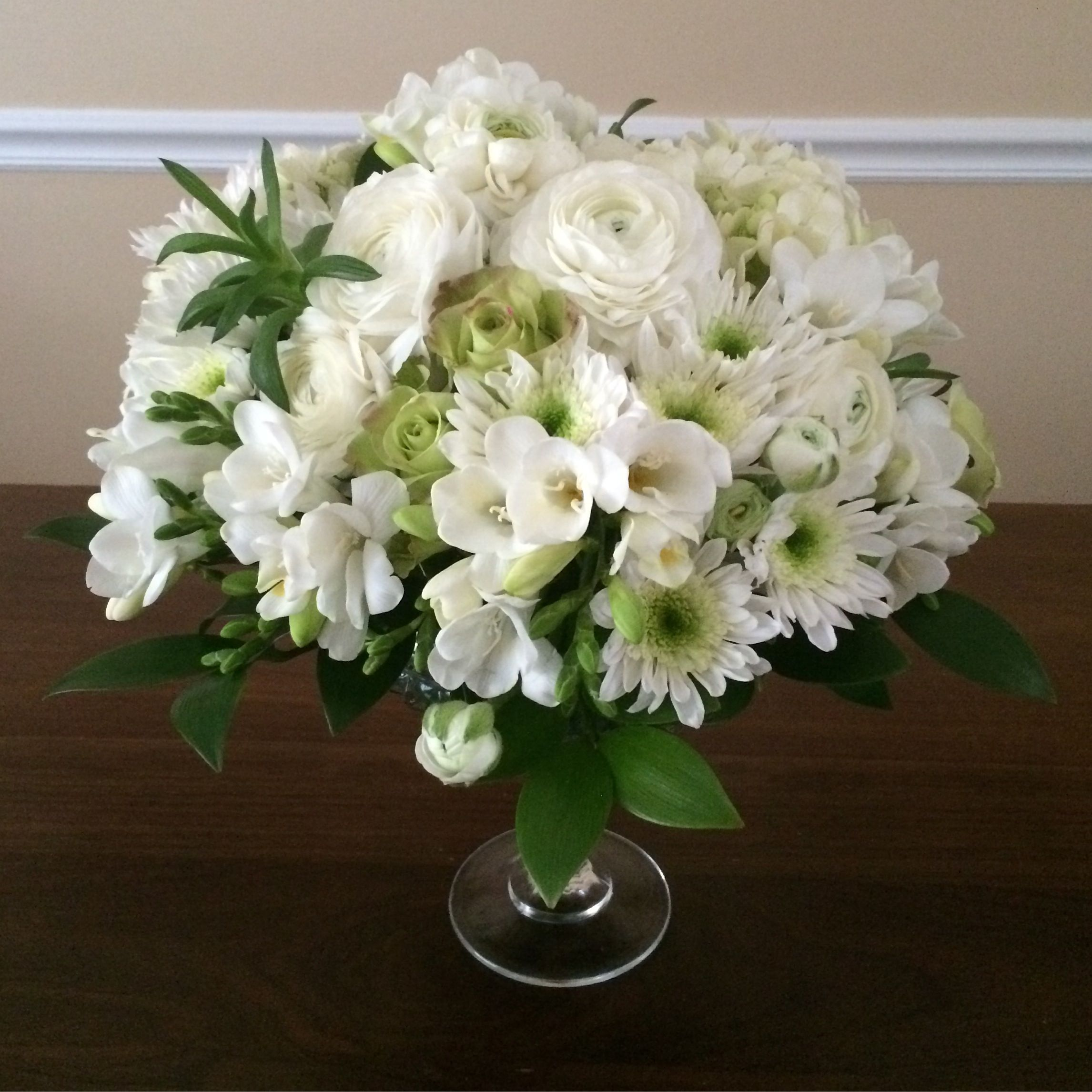 White green table centerpiece freesia ranunculus rose