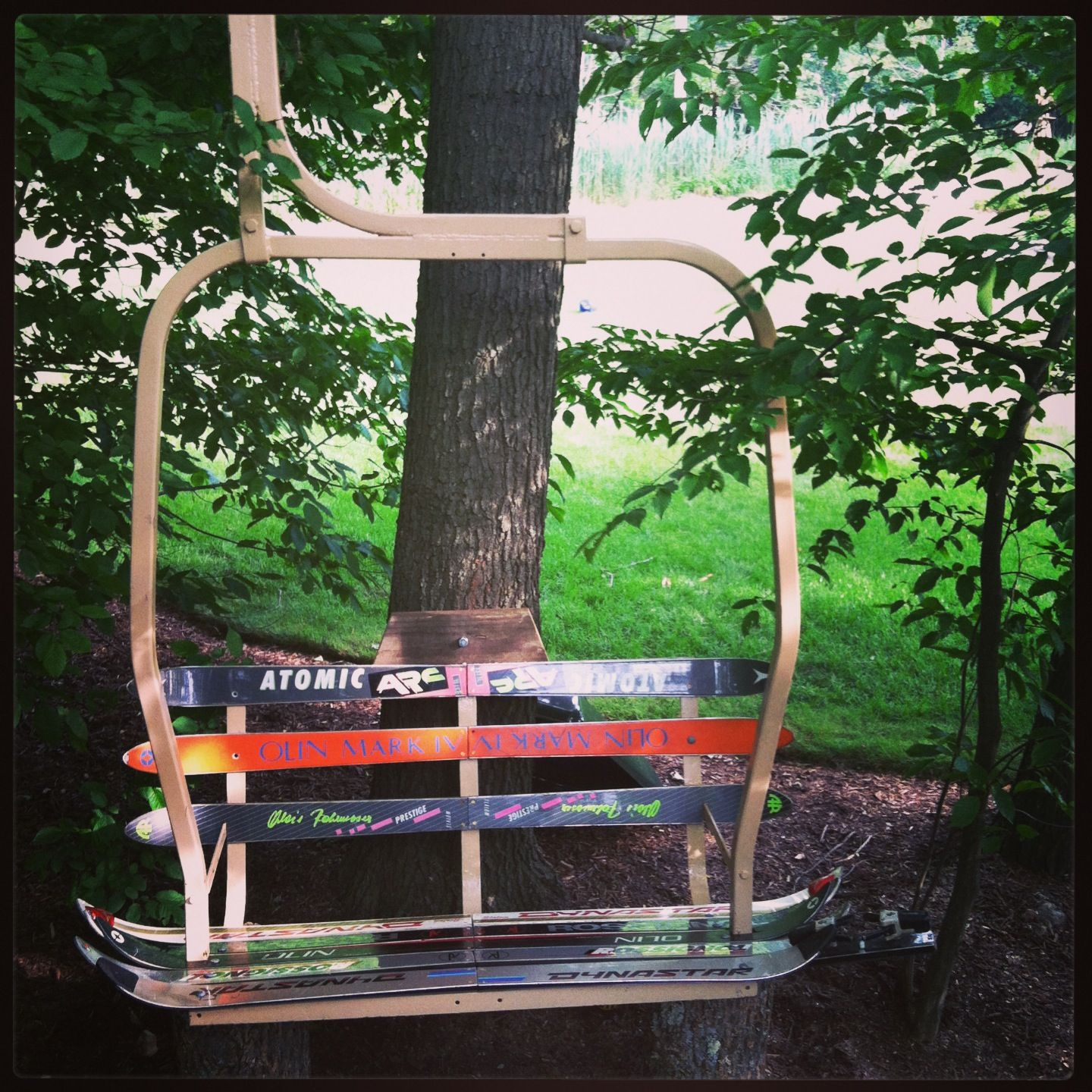 ski lift bench made from a ski lift and old skis do it myself