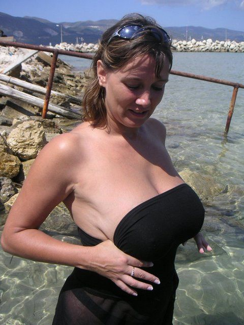Big breasts on the beach