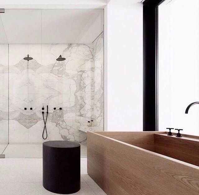 Wood bathtub and marble shower