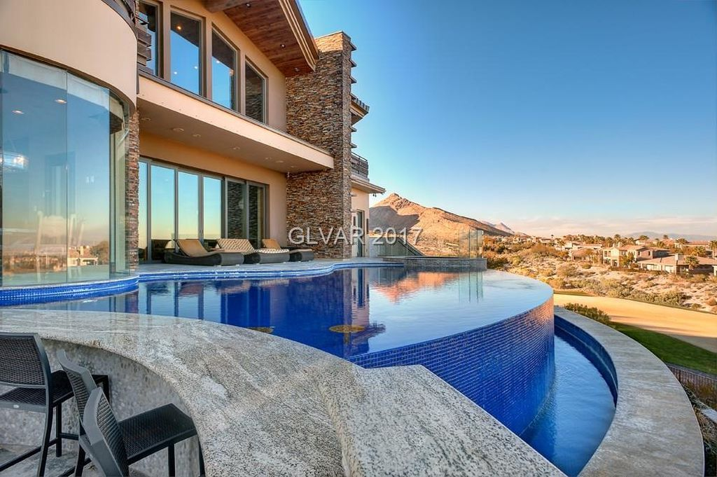 View 35 photos of this $7,950,000, 6 bed, 10.0 bath, 10591 sqft single family home located at 64 Promontory Ridge Dr, Las Vegas, NV 89135 built in 2011. MLS # 1869015.