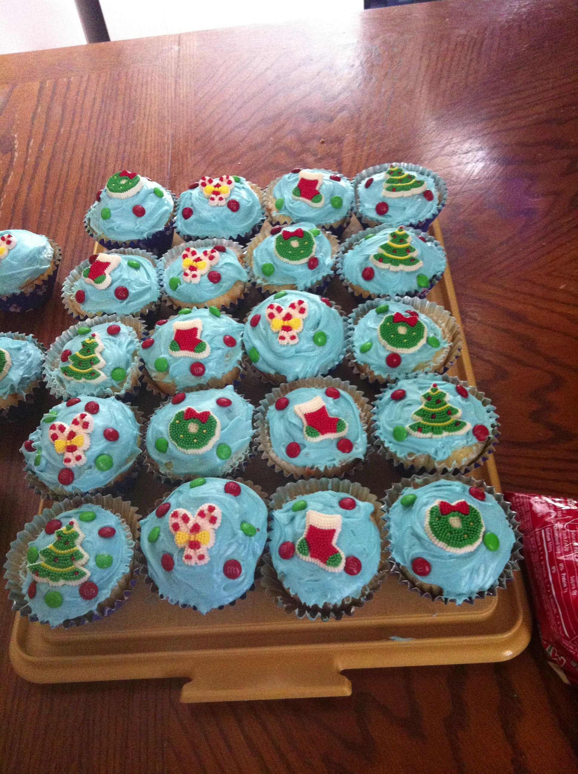 Christmas cupcakes i made rainbow chip cake topped with
