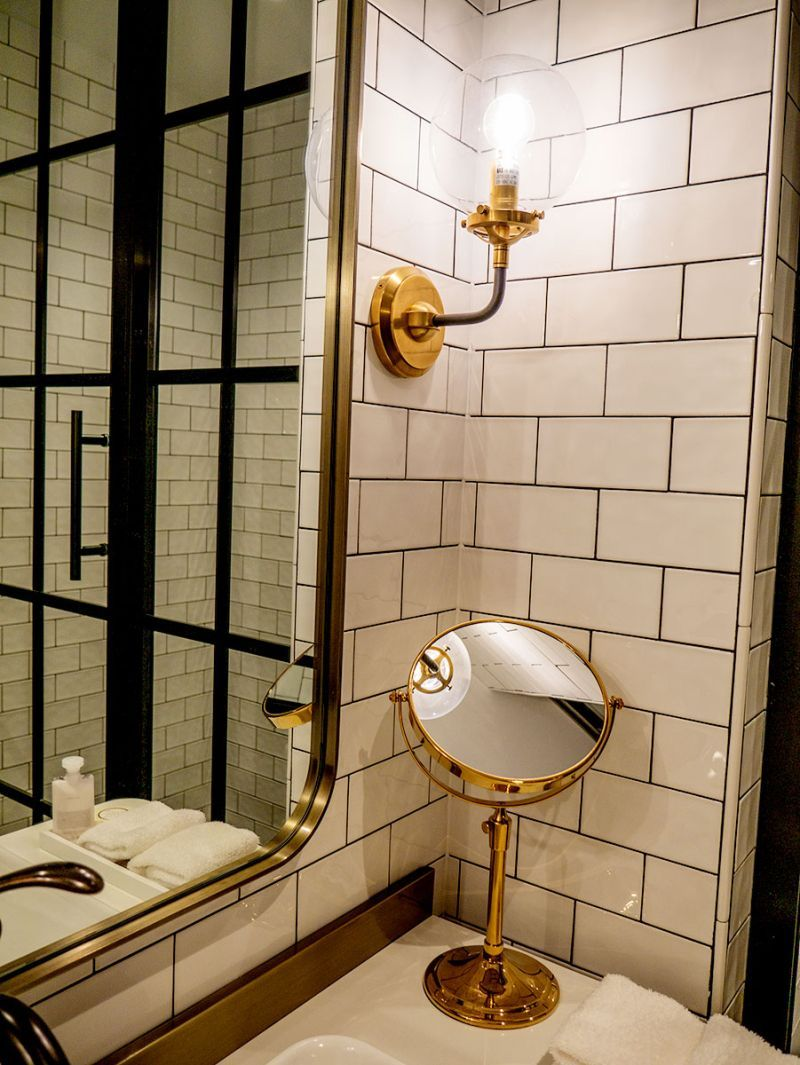 Photo of Bathroom: Subway tile and brass fixtures