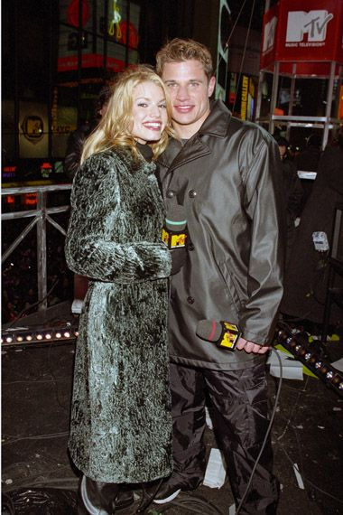 98 Degrees lead singer Nick Lachey and some woman he used to date. Vote here >> http://www.mtv.com/content/news/2012/boybandbattle/