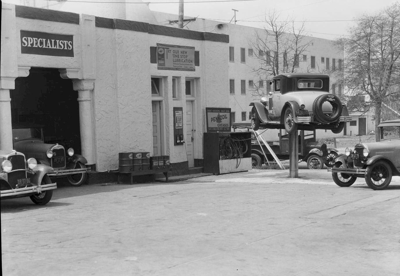 Cars & grease rack at service station, 4982 Hollywood Blvd