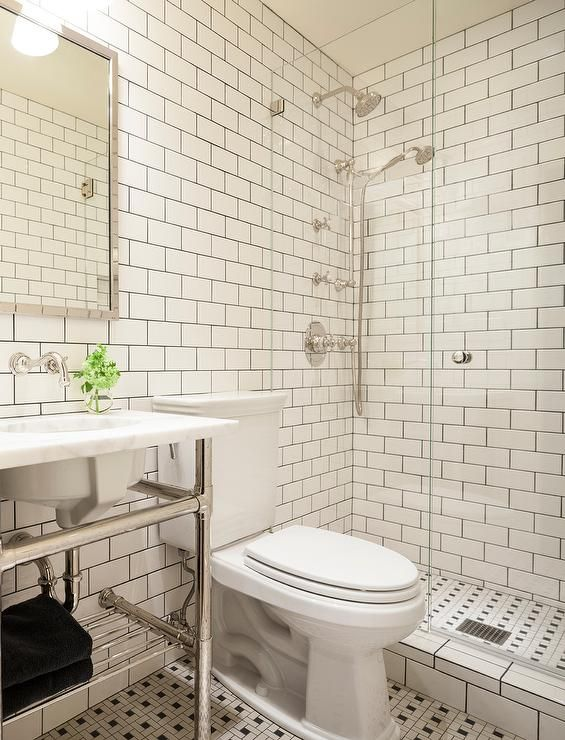 Stunning Black And White Bathroom Features Walls Lined With White Subway Tiles Accented With Black Gr Tile Bathroom Subway Tiles Bathroom Bathroom Tile Designs