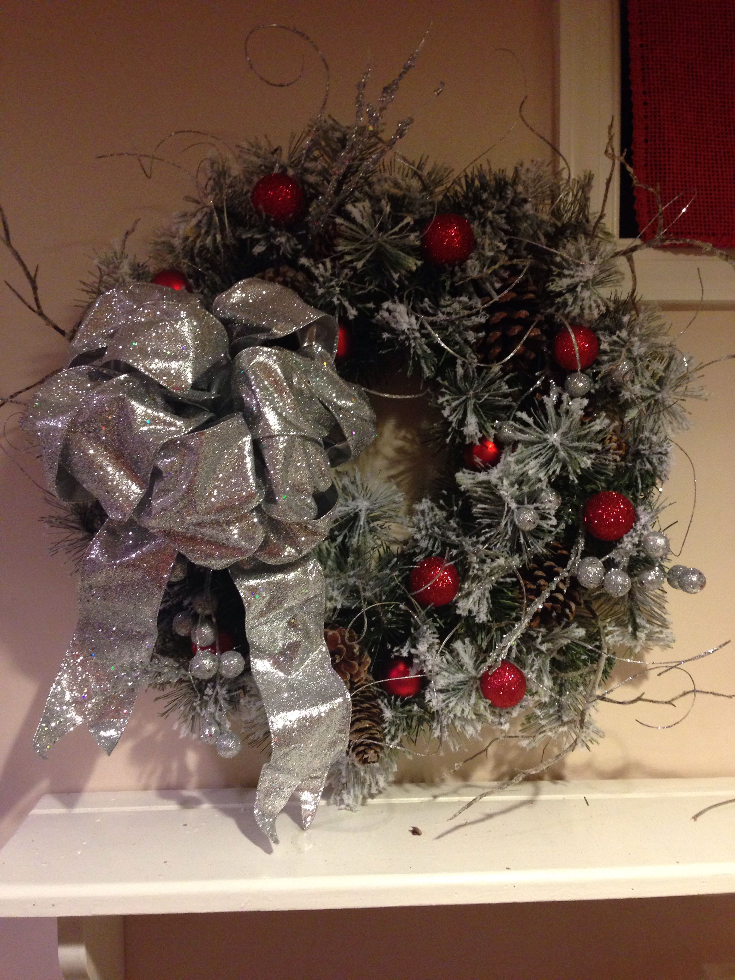 My christmas wreath! 7$ clearance at Kmart. Only added bow, twigs ...