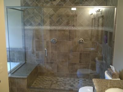 dual shower, Right side regular shower heads, left side bench with ...