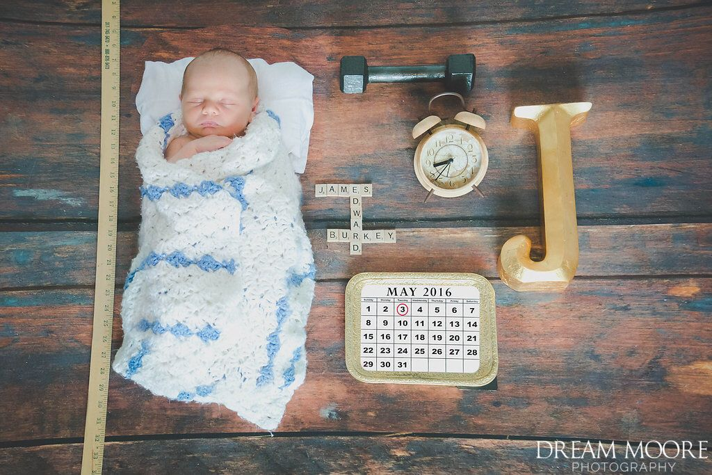 My sweet baby, in a literal birth announcement Photo credit: Dream Moore Photography