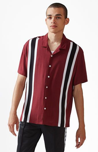 4712e88eab5 Take the retro route on top with the PacSun Striped Short Sleeve Button Up  Bowling Shirt. This lightweight shirt has short sleeves