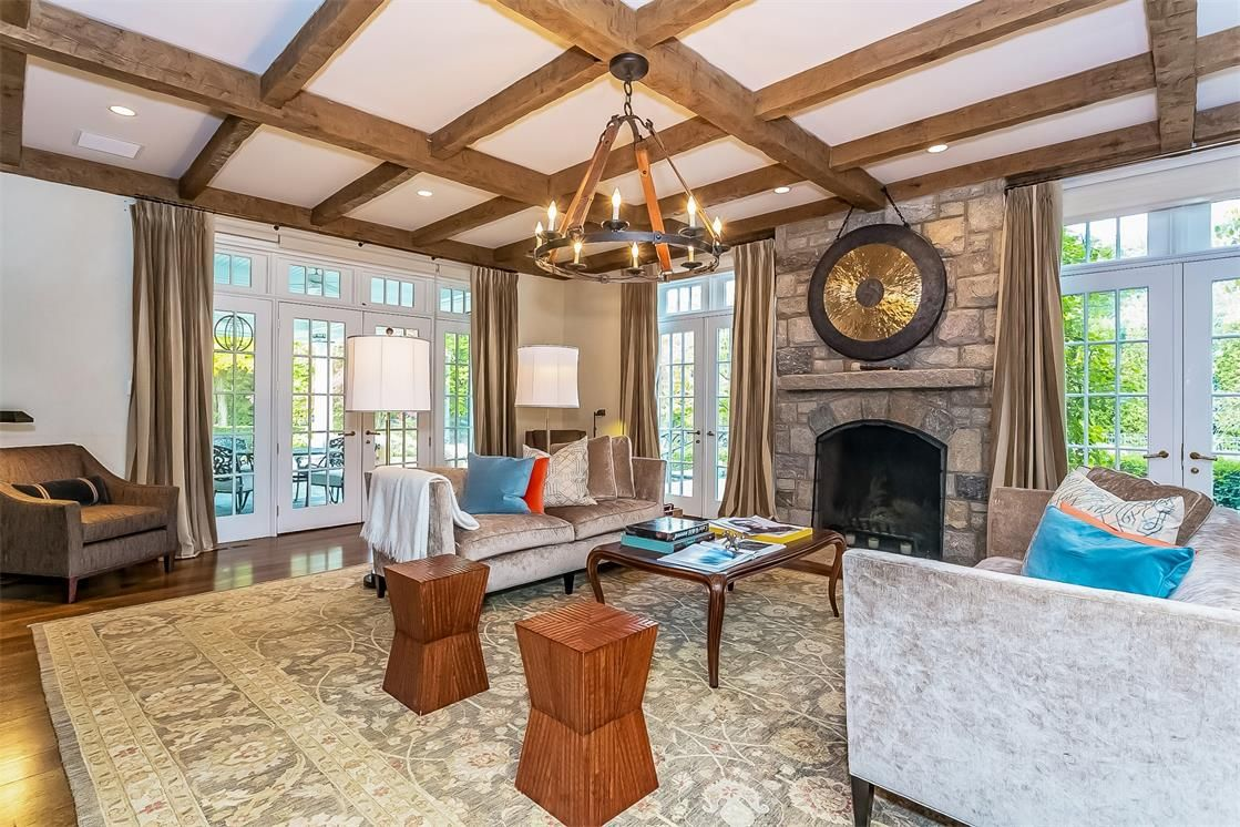 A fireplace can make any room (no matter how large) cozy! http://blog.juliabfee.com/2014/11/keep-the-home-fires-burning/