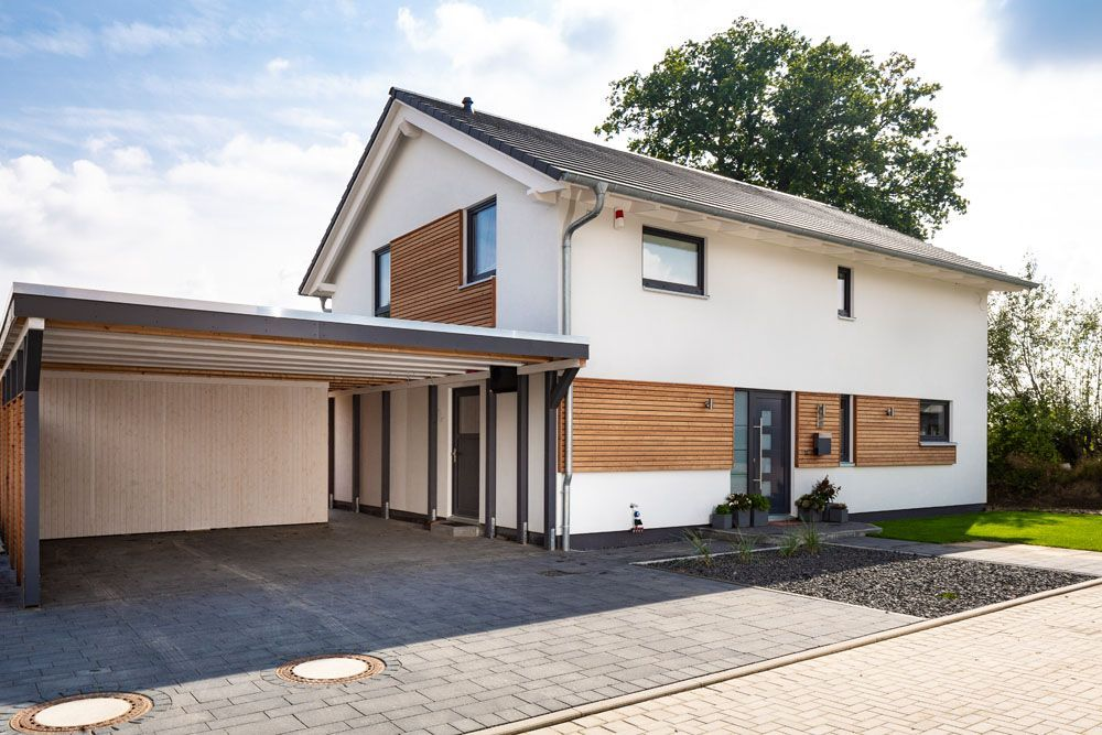 Wohnen Und Arbeiten Two Storey House House In The Woods Garage Design