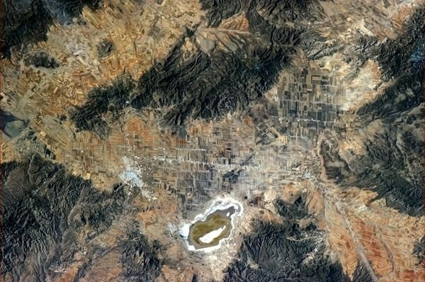 Intricate patchwork fields and a Rolling Stones-esque lake, northern Mexico.
