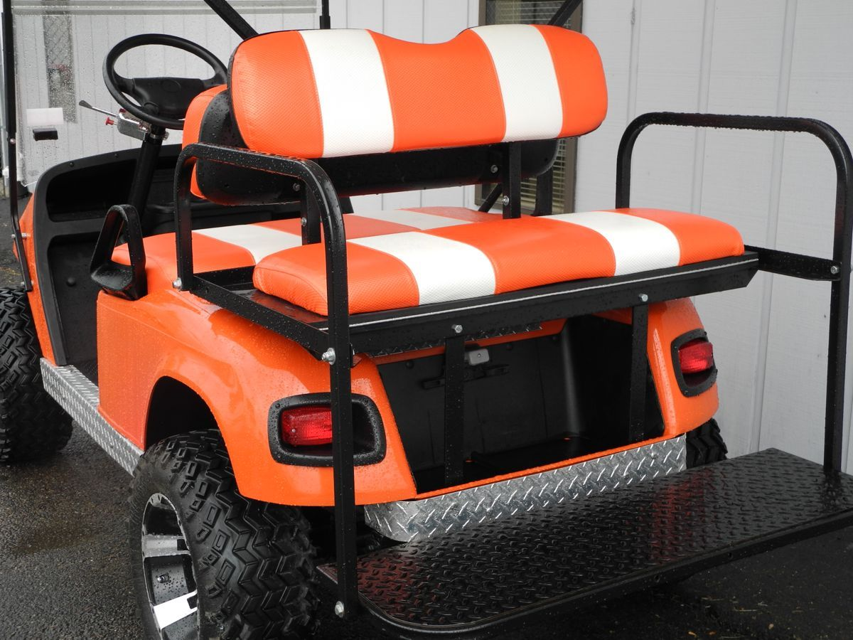 This E-Z-GO TXT is decked out with lift kit, premium lights, rear ...
