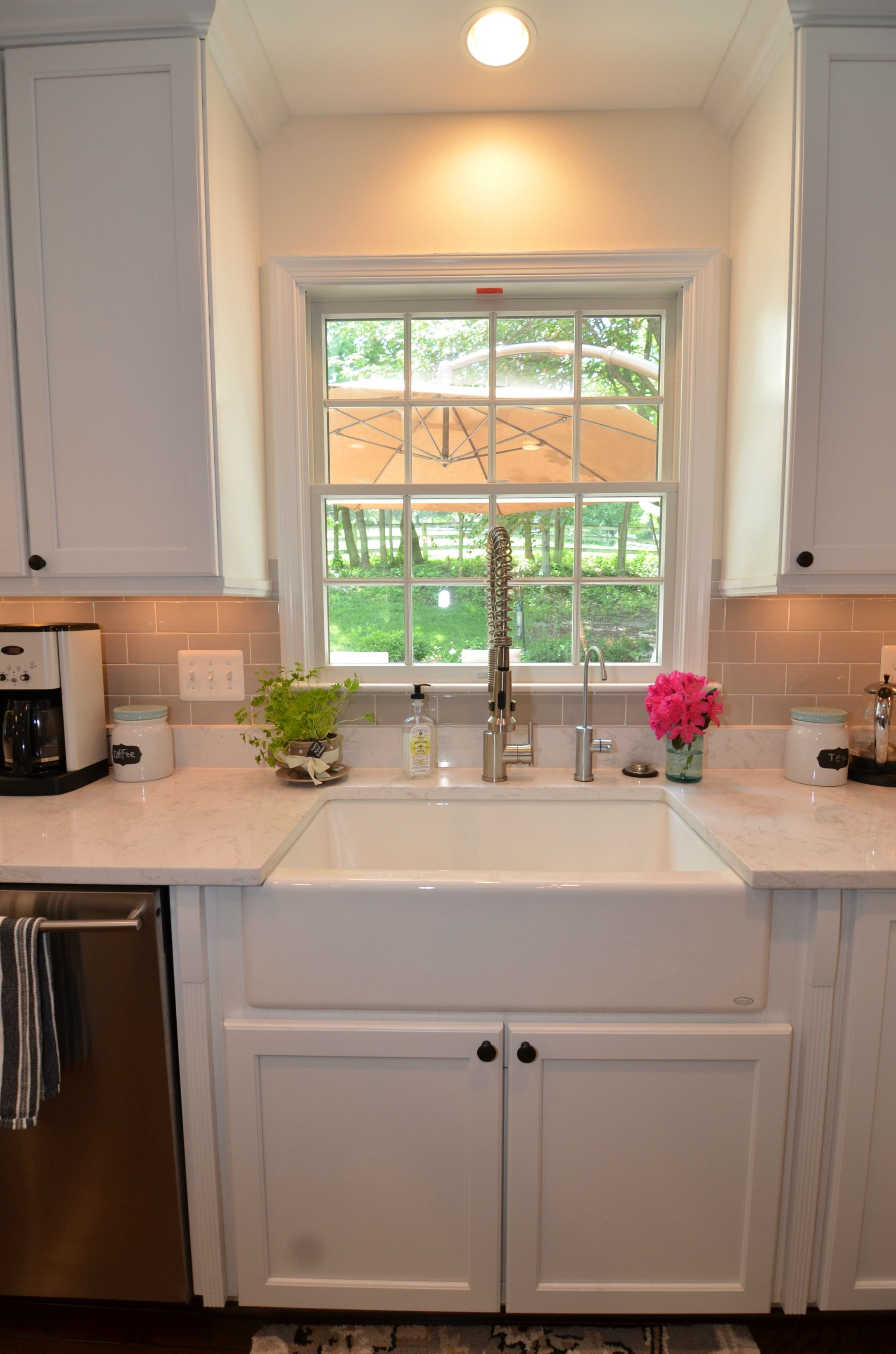 White cabinets farmhouse style sink and cambria torquay for Cambrian kitchen cabinets