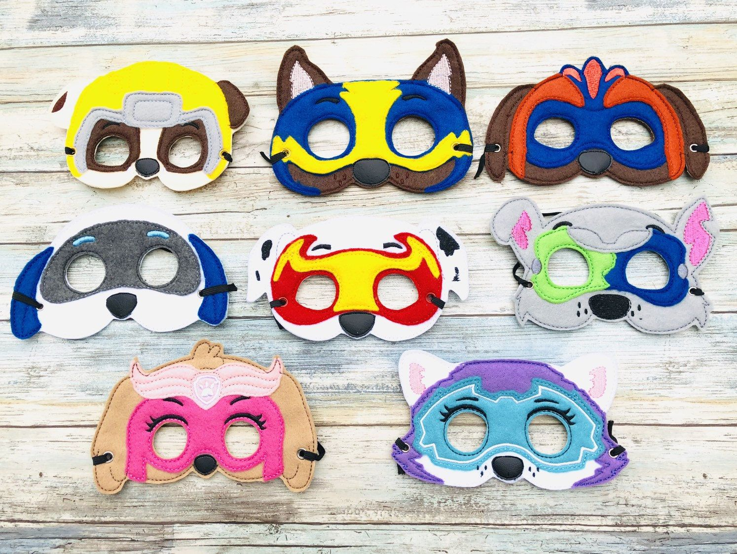 Embroidered mask  Mighty pups Paw patrol - Paw patrol birthday, Paw patrol party, Paw patrol, Paw patrol stickers, Paw patrol masks, Face masks for kids - Embroidered mask  Made of  felt This mask is embroidered  Its made of felt  and has a soft felt back for the comfort of your child  There is a 15 inch elastic band that will fit most children   The elastic allows your child to wear and remove the mask easy  Perfect for Birthday party  Halloween