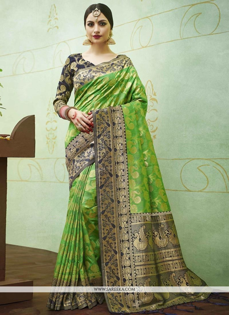 0d2343ed5a Real beauty will come out of your dressing design with this green banarasi  silk designer traditional saree. The ethnic weaving work in the dress adds  a sign ...