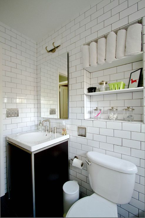 Amazing Bathroom With Niche Filled Shelves Above Toilet Next To Black Washstand White Porcelain Sink Paired Frameless Mirror And Subway