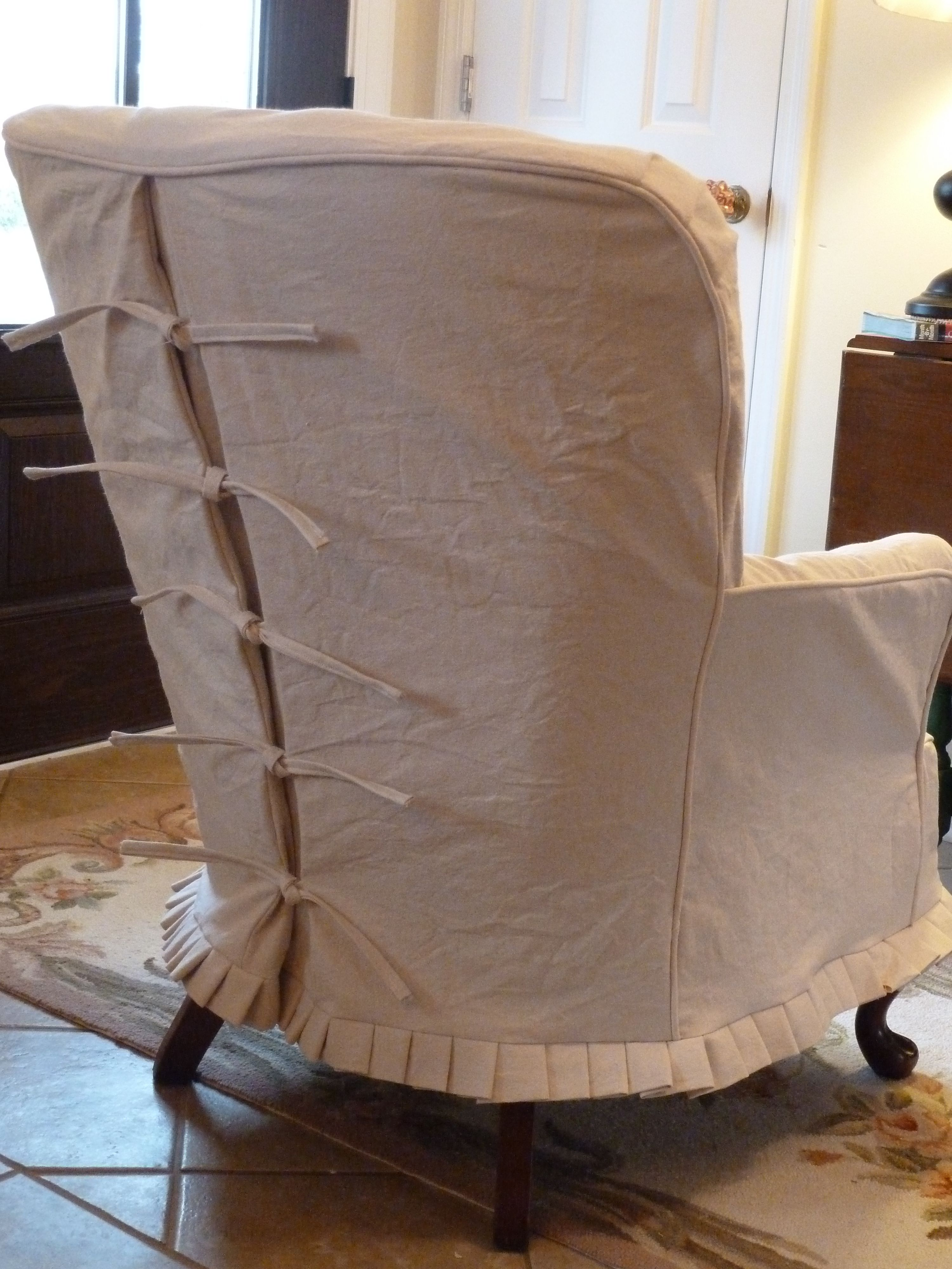 Drop cloth slipcover with back detail.