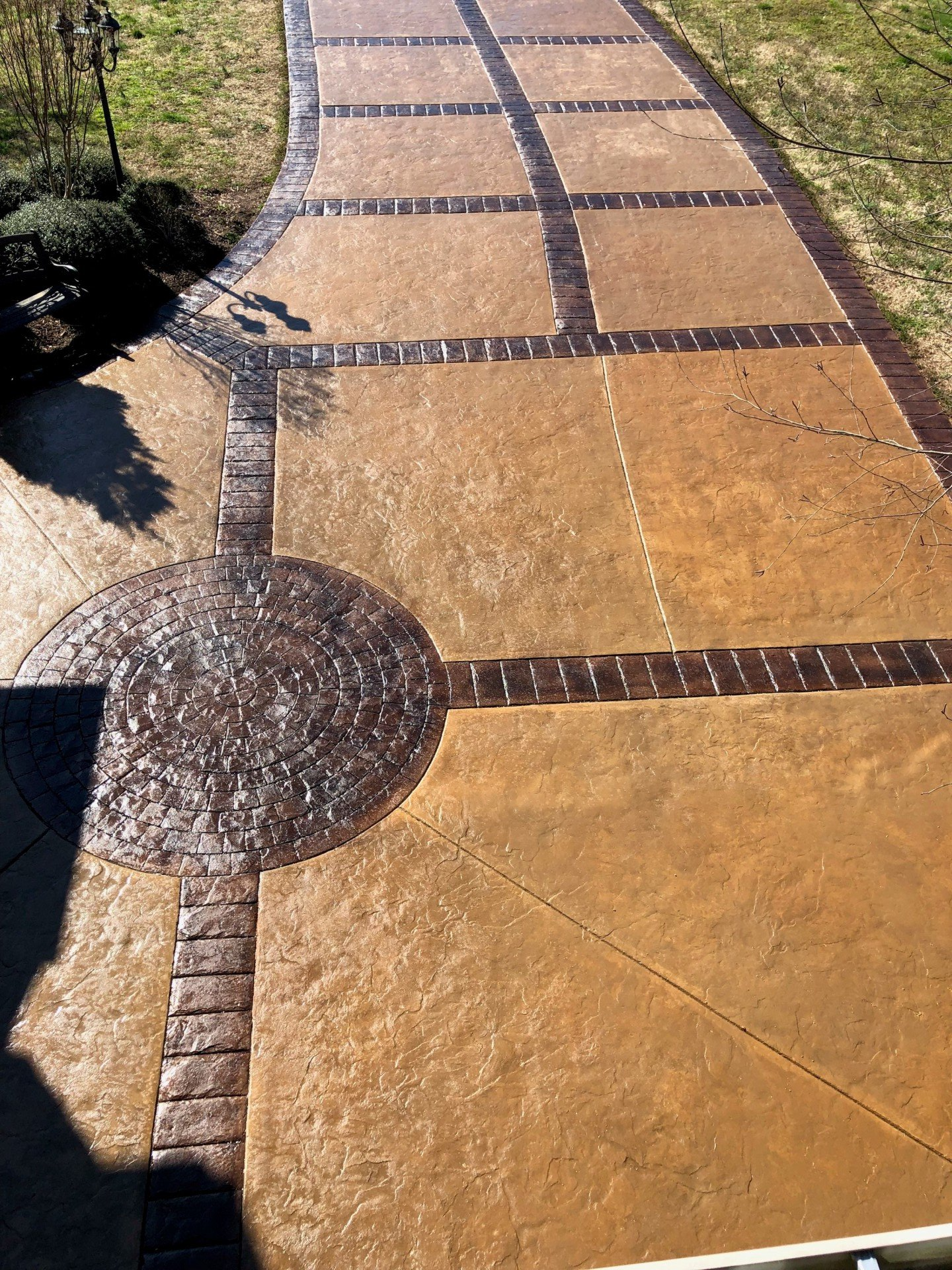 Stamped Stained Concrete Color Taupe Border Color Walnut And Chocolate Brown Decorati Stained Concrete Stamped Concrete Decorative Concrete Driveways
