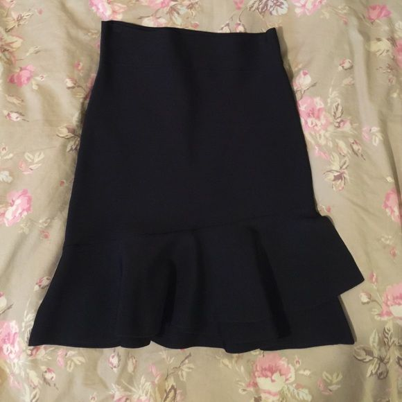Bcbg skirt Ruffle along bottom, form fitting skirt. Super cute! High waisted! Slight damage where the hanger was placed on both sides of the top. (See photo!) BCBGMaxAzria Skirts