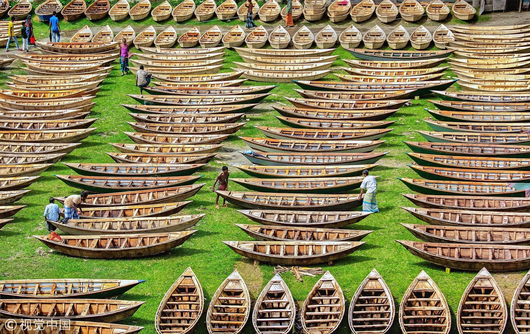 Hundreds of wooden boats are prepared for rainy season in
