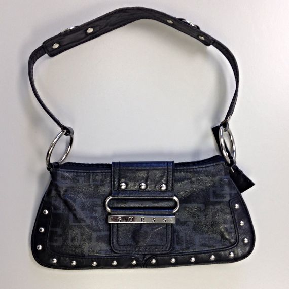 Like new black baguette.  Worn once. 9 1/2 width.  4 1/2 deep.  strap drop 8 inches.  G logo grey on front and back of the bag.  Silver hardware.