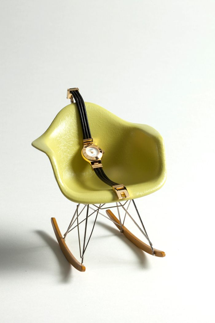 A 1988 Fossil Pebble Line Watch Sitting Pretty In A Mini Eames Rocker