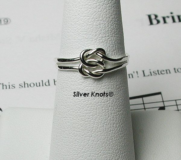 Sterling Silver Double Loveknot Ring Skinny and Cute. $8.99, via Etsy.